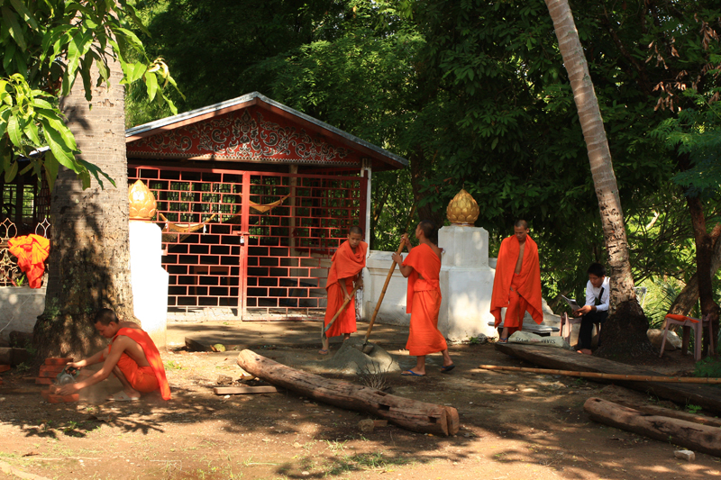Monks working at a temple, Luang Prabang
