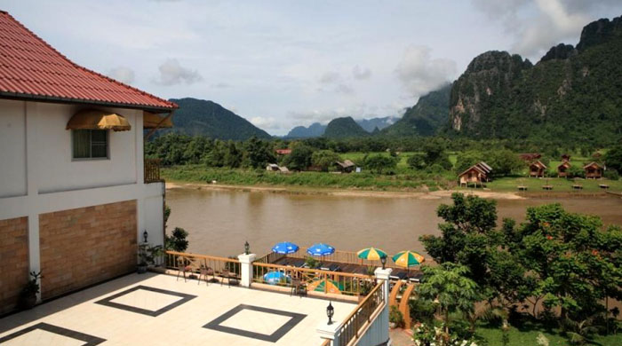 Luxury travel to laos what to do and where to stay for Domon river guesthouse vang vieng