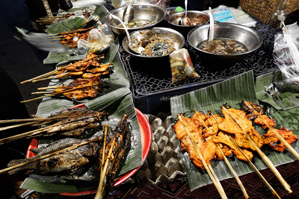 Tradional fish and chicked grilled street food, Laos.