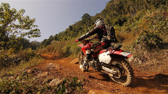Motobike trip through Laos to the Plain of Jars