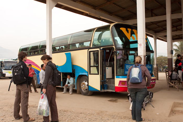 Tourists take the bus to Luang Prabang