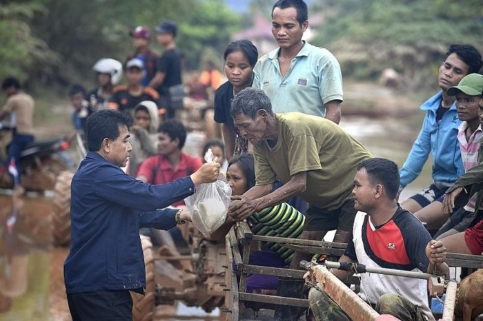 Relief goods are delivered to people at Sanamxai, Attapu, Laos